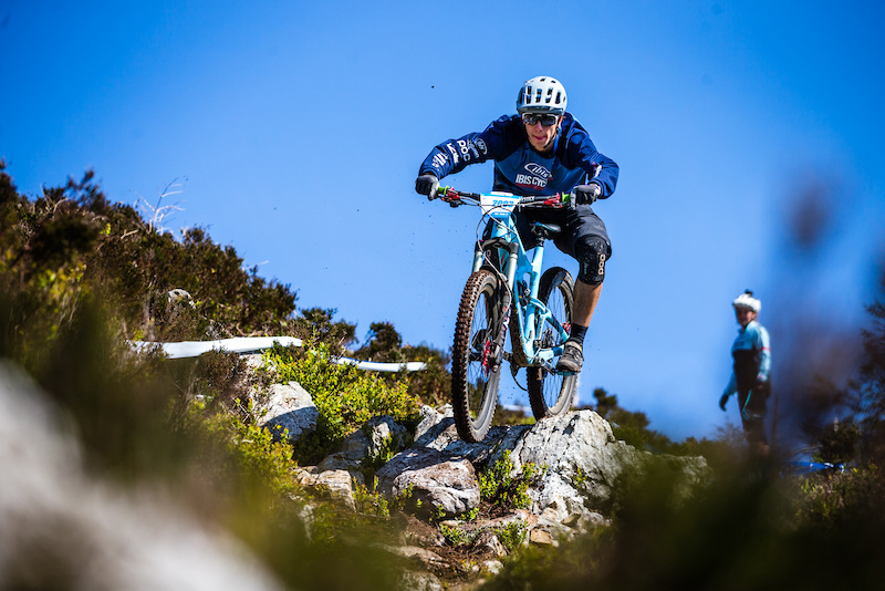 Pedro easily weaving his way through the many rocks on course