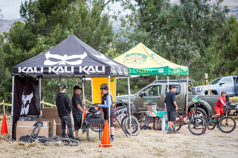 Kali protectives and Trail Head Cyclery both had display tents on hand for the Ground Breaking. The tents also made an excellent location for a group photo of some of the attendees and people involved in planning the bike park.