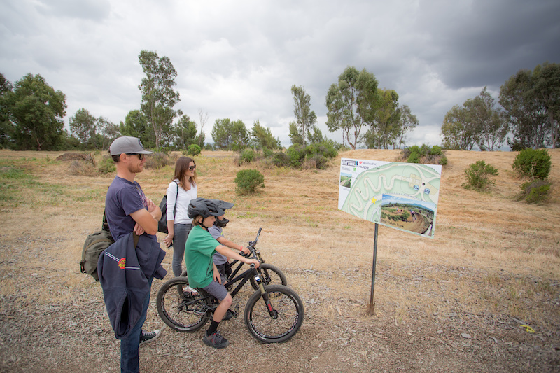 Dustin Vaughn-Luma his wife Lindsay and their two boys Luke and Dominic took the tour of the plans for the upcoming bike park. Here they look at the Slalom area. The City is planning on hosting a monthly race series for Dual Slalom and Pump Track something the Vaughn-Luma s are excited about.