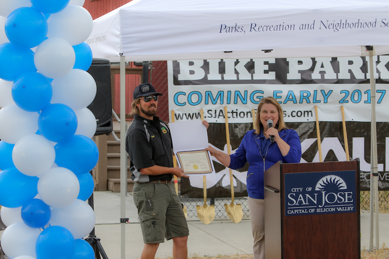 Vice Mayor Rose Herrera hands an award of accommodation to Trail Head Cyclery Owner Lars Thomsen. Trail Head Cyclery is a local bike shop about 20 minutes from the location of the park. When asked how he felt the park would impact the shop Lars said It will be great for us. We will add a rental fleet of DJ bikes and will stock parts and accessories for that rider group . He mentioned other locations such as Calabasas a place where local Ryan Nyquist grew up. Calabasas was a good place Thomsen said but it had a rougher crowd and was a place that wasn t closely monitored where as Cunningham is a city ran venue with supervision and it s super family friendly .