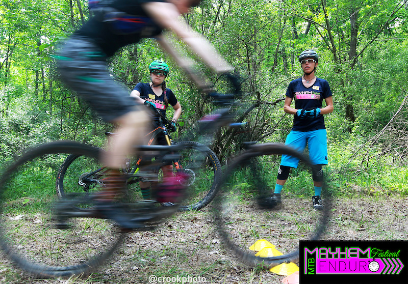 IMBA certified instructor Angie Weston left and Rae Gangolf watch a rider run through a drill during a skills clinic at the Mayhem Enduro Bike Festival.