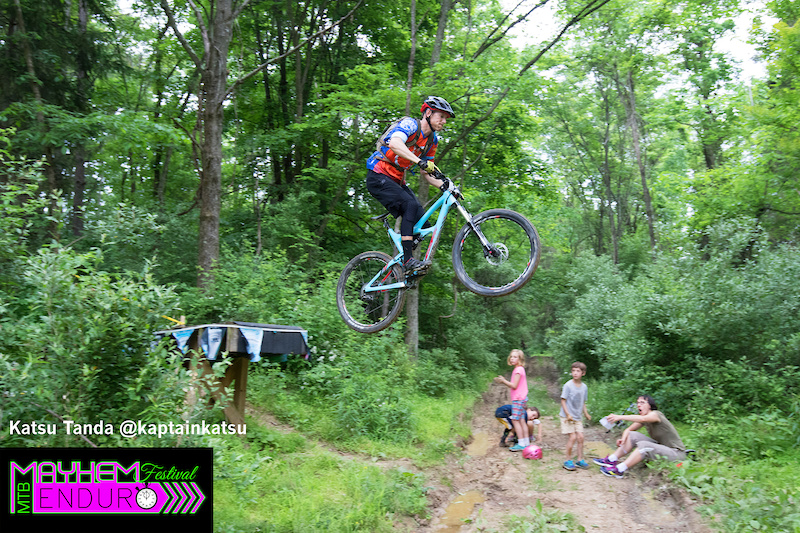 A rider soars over the road gap on the first stage of the Mayhem Enduro in Cumberland Ohio on May 29 2016.