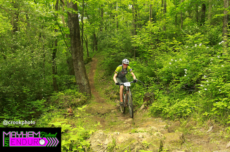 A ride rumbles through a rock garden on the fourth stage of the five-stage Mayhem Enduro in Cumberland Ohio on May 29 2016.