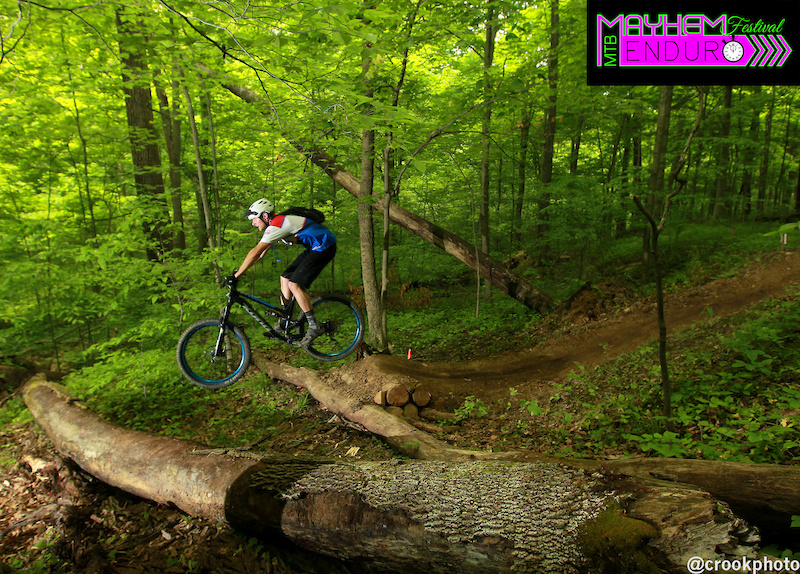 Riders clear a jump near the end of the fourth stage of the 2016 Mayhem Enduro in Cumberland Ohio on May 29 2016.