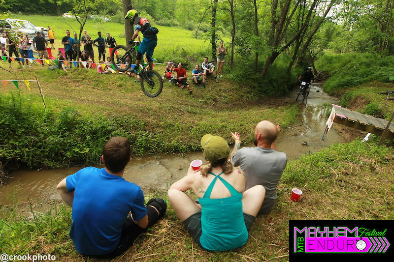 One rider clears the creek gap at the end of the final stage of the 2016 Mayhem Enduro in Cumberland Ohio on May 29. Another rider can be seen riding the go-around through the creek.
