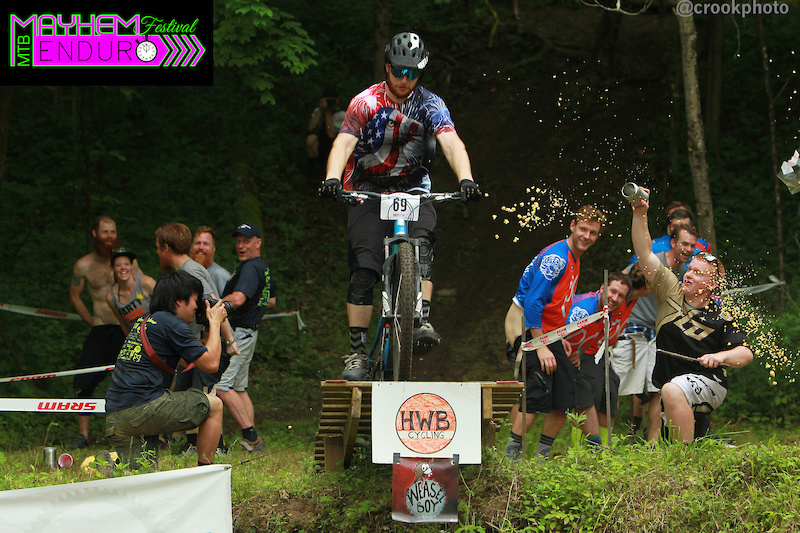 A rider clears the creek gap on the final stage of the Mayhem Enduro on May 29 2016 in Cumberland Ohio.
