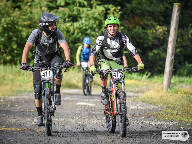 The transition stages are an opportunity to chat with new friends here Paulo Valle of the United States chats with Chad Hendren of Canada during the SRAM Canadian Open Enduro Crankworx Whistler 2015. Photo by Scott Robarts .