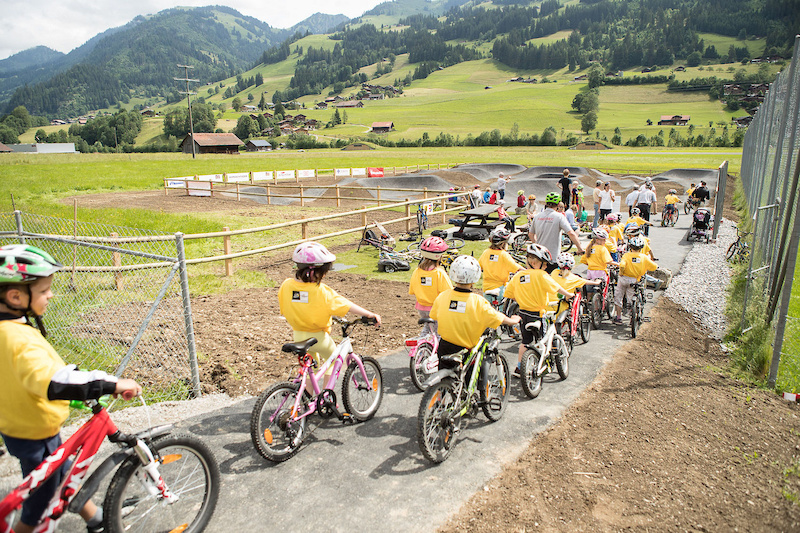 Velosolutions asphalt pump track opening in Zweisimmen Switzerland with Brendan Fairclough Adrien Loron and Claudio Caluori.
