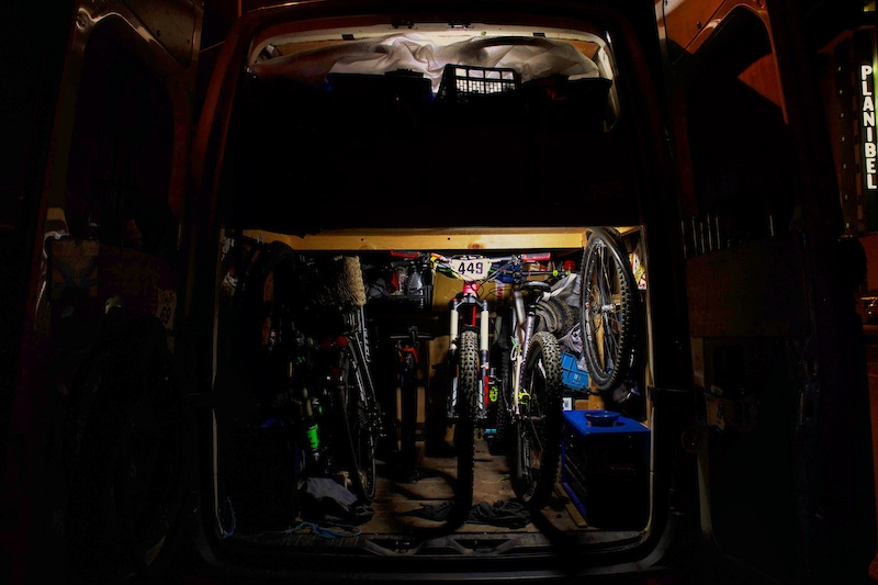 Raphaela s race bike tucked away safe and sound for the night in the back of my van ready for the EWS in La Thuile