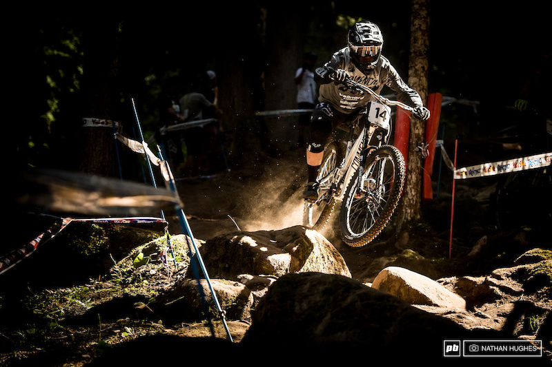 Brannigan hurtling through beams of light in the forest.