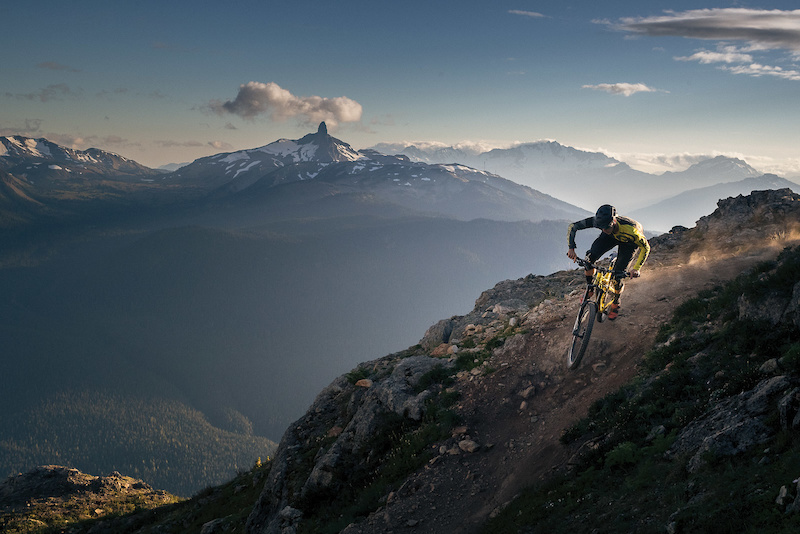 Dropping off the summit of Whistler Mountain is a surreal experience the alpine chair ride the 360-degree views and the 5 000 feet of world-class singletrack that follows. Spencer Wright throws a little dust on Top of the World one of Whistler s most iconic trails. Photo Robin O Neill