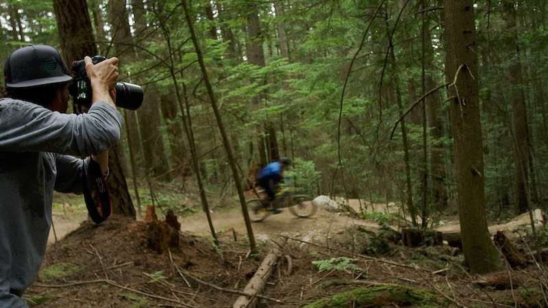 Photographer Sterling Lorence capturing the action as Thomas the Kid Vanderham flies past.
