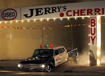 In celebration of the 35th anniversary of the 1973 film American Graffiti, a film crew re-created the cop car scene early Thursday morning