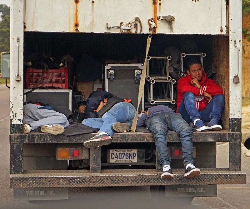 Why are Guatemalans so relaxed tranquilo in traffic Young men commuting to work in their work truck on the highway through Chimaltenango