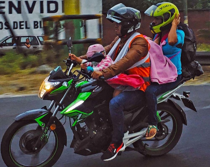 Fully loaded motorcycle on the road near Escuintla. Motorcycles are the most popular transport. Photo Juan Delaroca