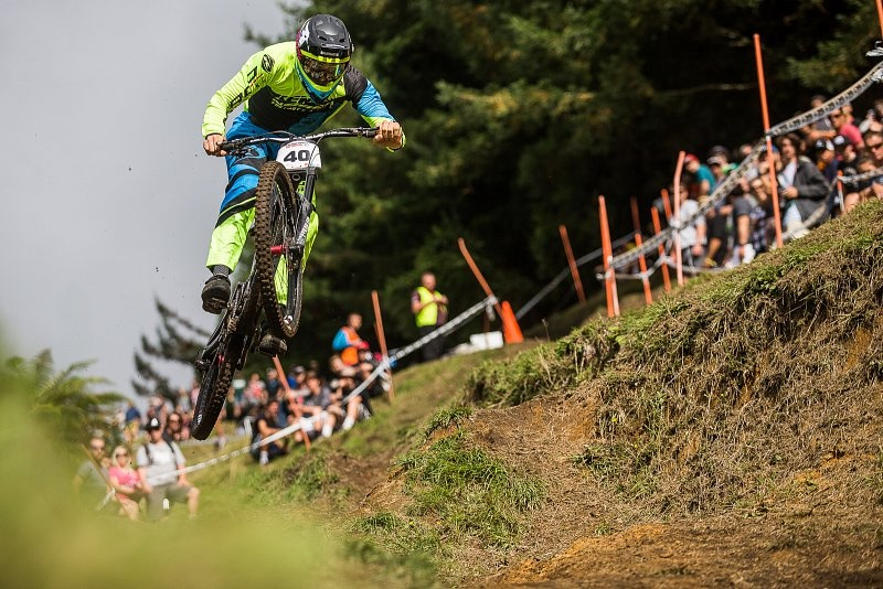 Launchiing into the final section of the Rotorua IXS Downhill race. Crankworx Fraser Britton photo.