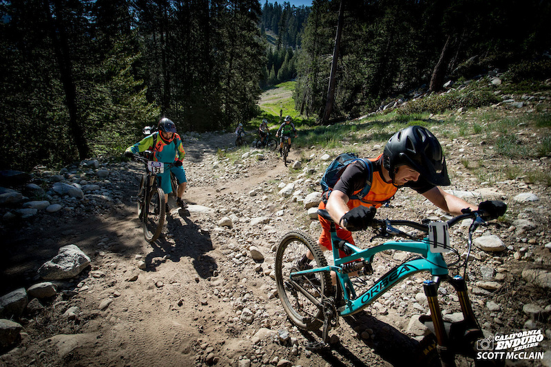 What a way to start the day. Evan Turpen Orbea pushes up a grueling steep section of the first transfer for Pro Expert.