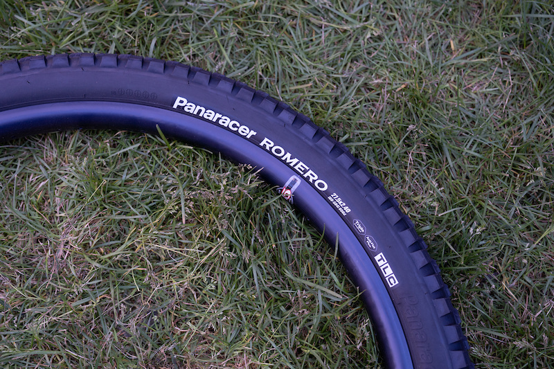 Panaracer Romero: A new all-condition tire with much emphasis given to the transition from the center blocks to its well-reinforced edging tread. Dual-durometer rubber and under-tread protective layers ensure it will go fast and go the distance. Gravity and trail casings are offered, as well as  2.4 and 2.6 sizes in both 29 and 27.5 options.