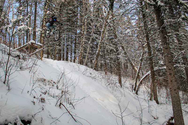Sending the big drop on one of Edmonton s best trails after a fresh snowfall.