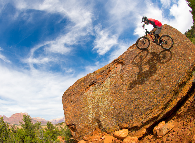 Nate Adams rides the Niner Bikes WFO9 on a rock wallride near Rockville Utah.