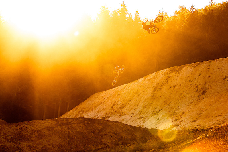 Signature Andreu style at Fest Sessions in Belgium on one of the new additions to the Loosefest line, a double sided hip. There's a brief moment of time when the sun is setting where it just catches the tops of the trees behind and just enough falls on the hip still. This was shot just as the sun was about to set behind the trees, during a mega train of riders leaving a cloud of dust, creating the perfect light to capture Andreu doing what he does best!