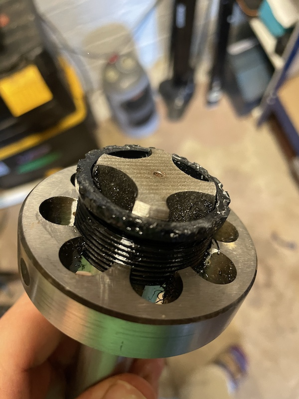 Cutting threads on the adaptor. Tap and die used at the same time to keep things round. This took a bit of trial and error to make work