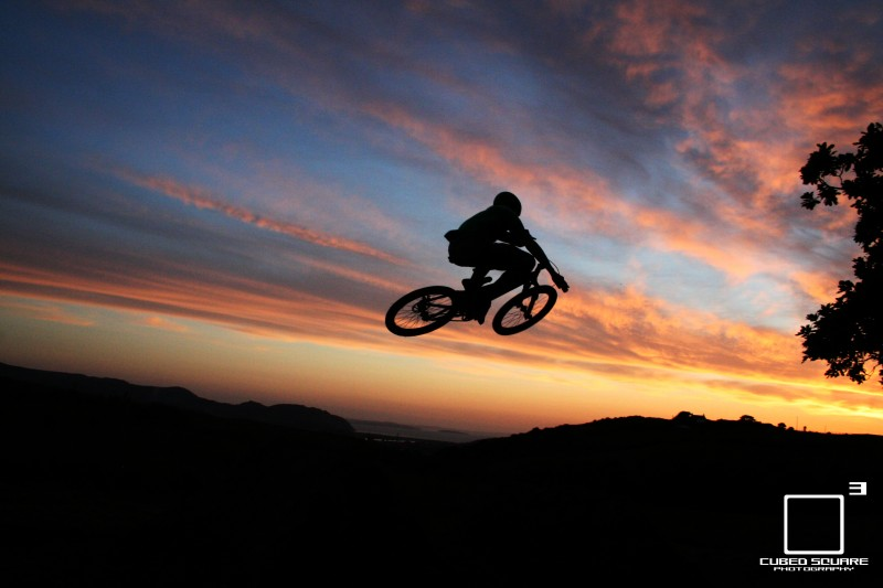 Duane throwing in a table in the sun set - Cubed Square Photography - Laurence CE