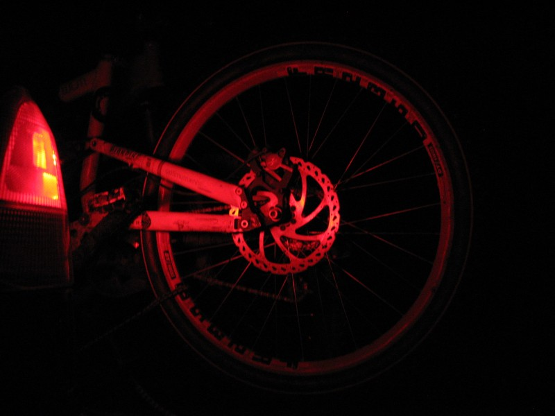 I was staring this red wheel all night during the drive. I thought it looked cool so i took a pic...ahh the things that you find cool when you bored out of your mind!