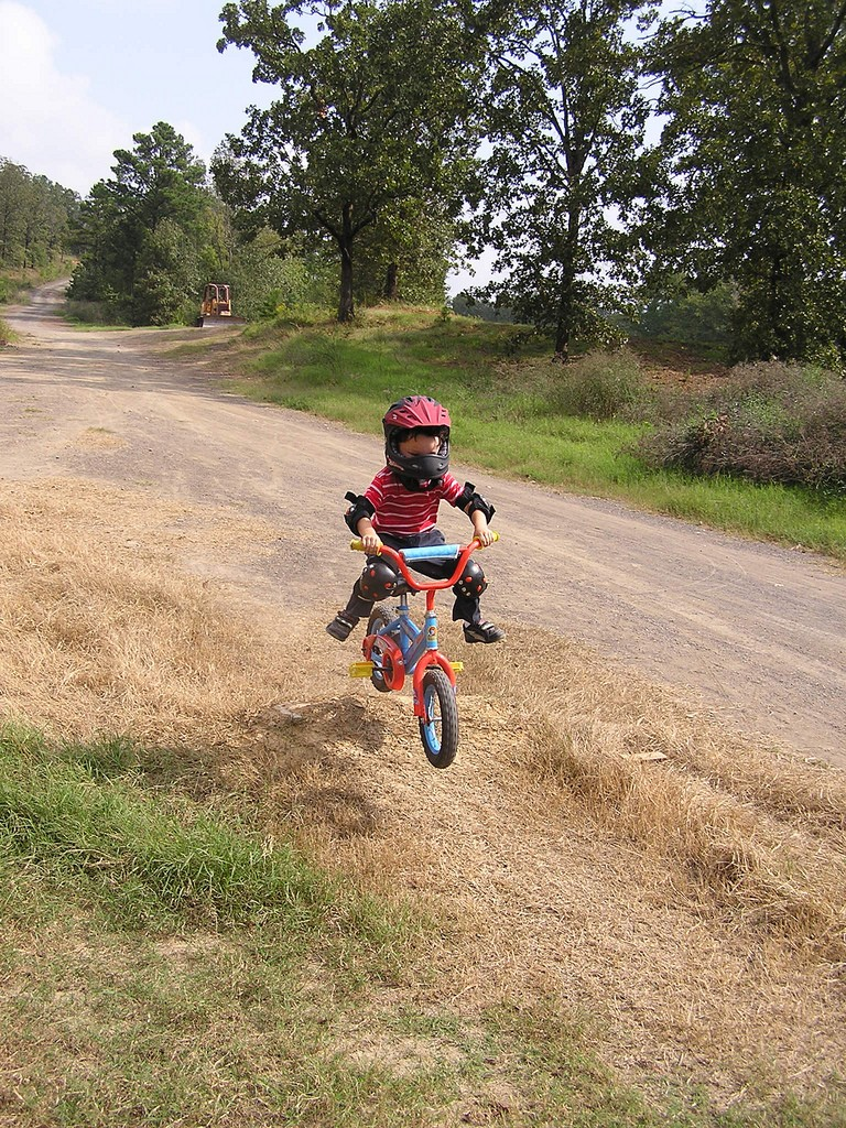Dylan pulling no-footers on his dirt jump the first day with no training wheels.