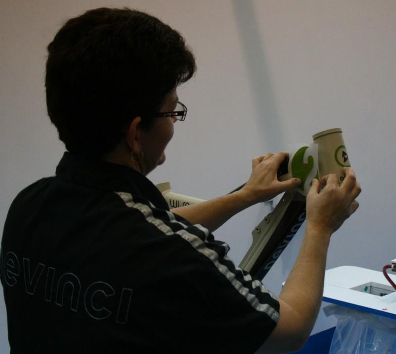 Devinci Factory Tour - applying decals.