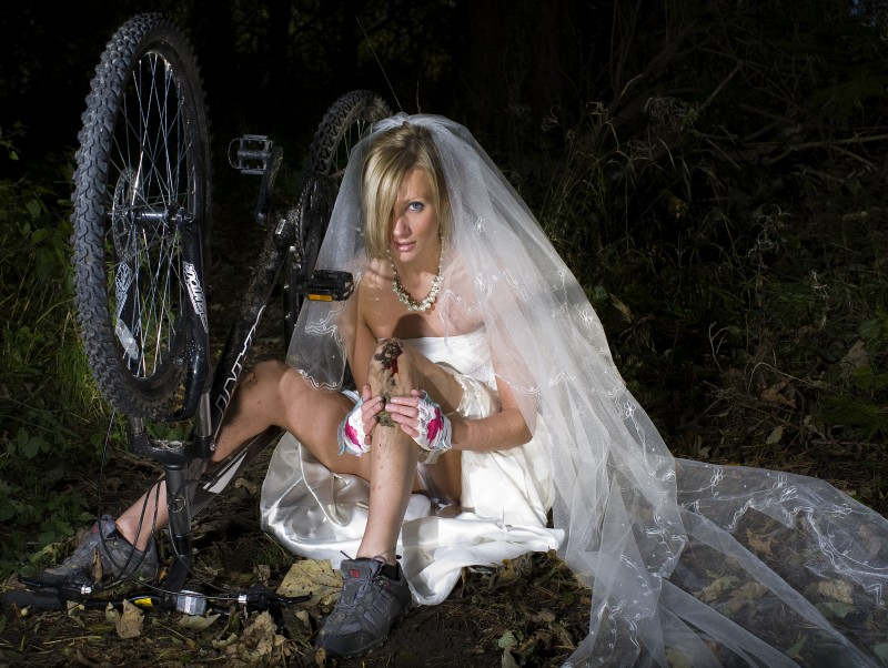 trashing her wedding dress on a giant mountain bike