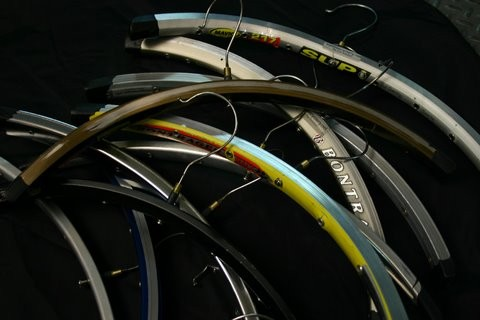 Recycled rims turned into hangers. kits for bike shops to produce there own are available at www.sunrisecyclery.net