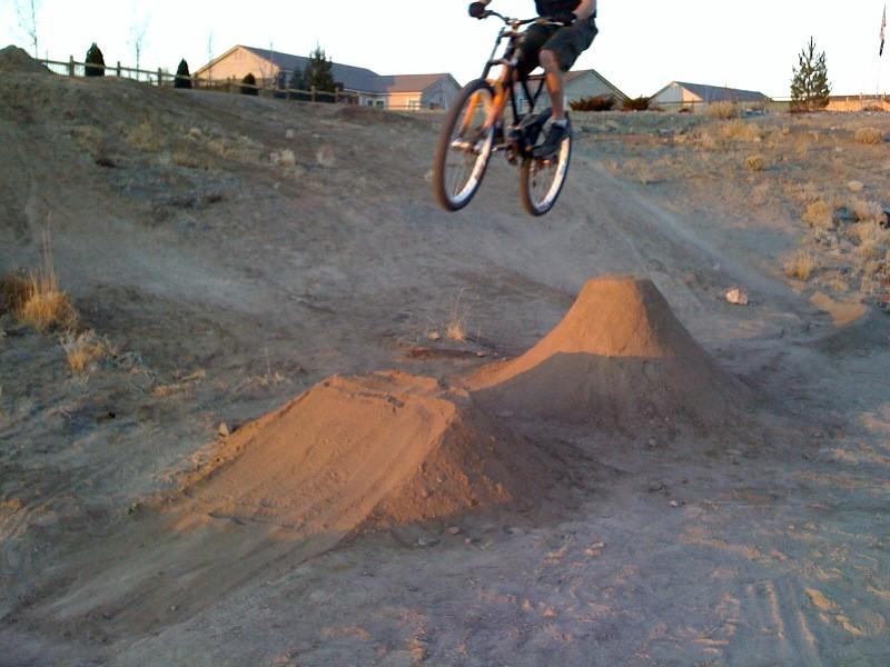 Jumping a jump in my friends backyard.