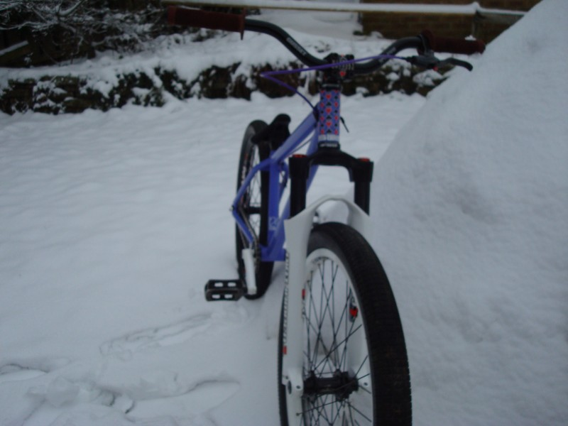 my bike with new fork and wheel next to my igloo