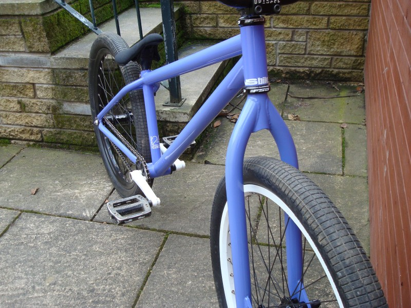NS suburban24 with my rebate painted to the same colour purple and also with the disk brake mount grinded off the fork. brakeless