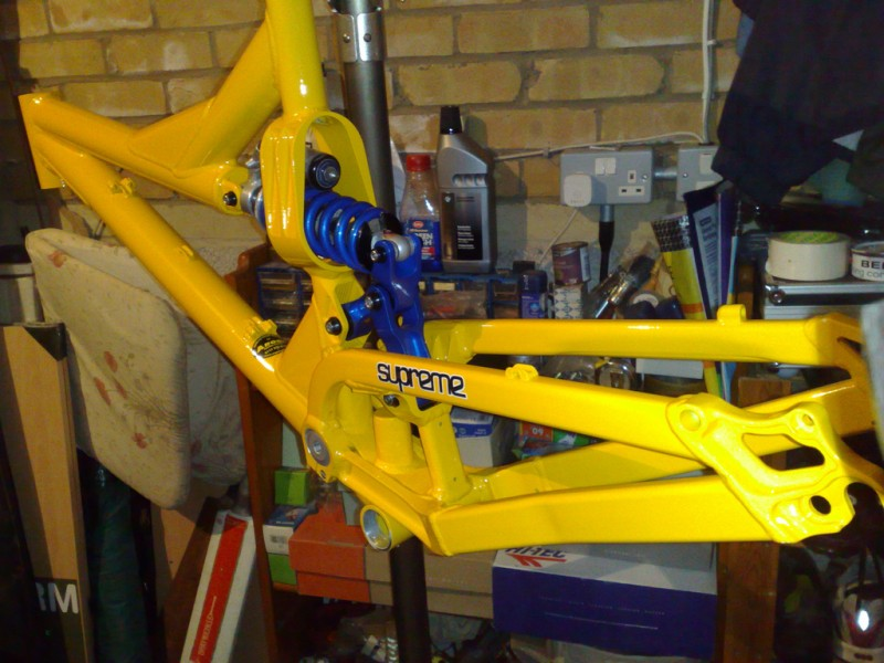 Custom respray by Argos Cycles (http://www.argoscycles.co.uk/) in Sunset Yellow with linkage and spring done in blue.