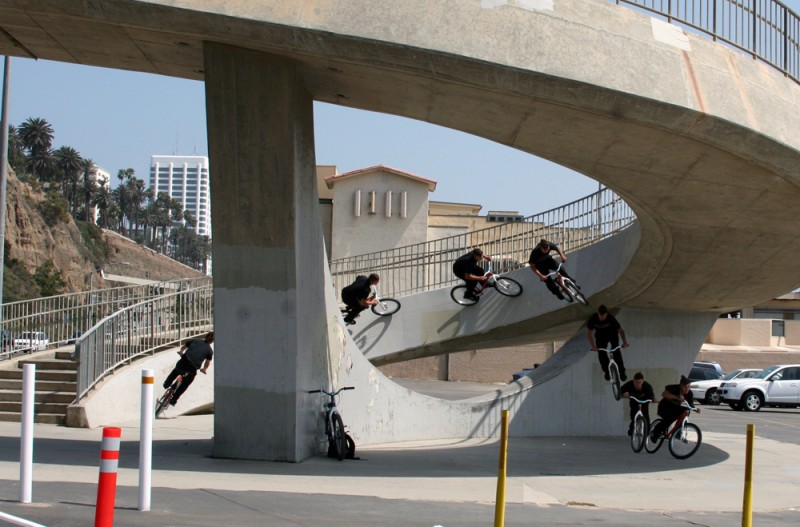 This is most likely the most insane curved wall ride on the planet. The area where you drop off of this thing hovers around 15 to 17 feet. To flat concrete. Seconds after this photo was taken, the landing broke a brand new set of crank arms. This is just bad ass!