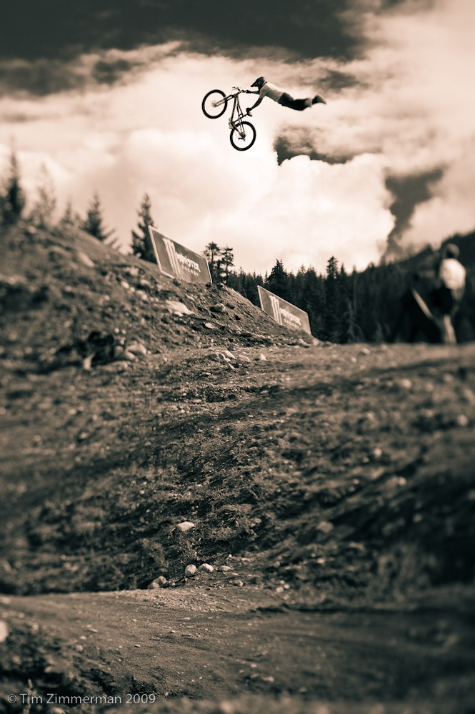 Greg Watts superman seat grabbing on his way to a win at the 2009 Kokanee Crankworx slopestyle in Whistler, BC.