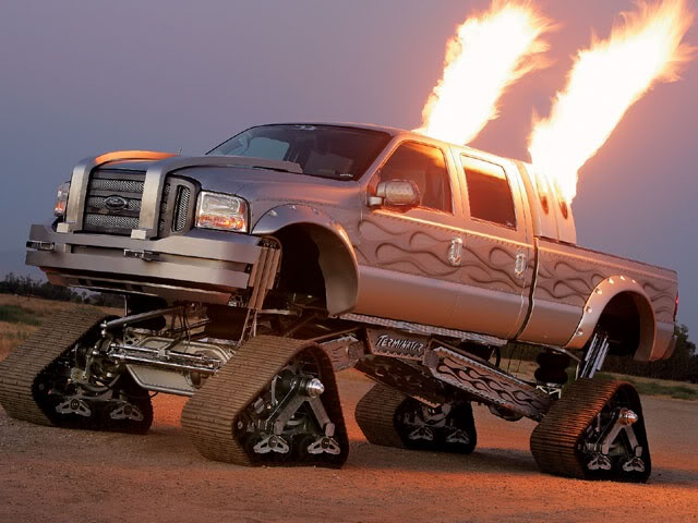 Sick F-350 fitted with tracks and flamethrowers