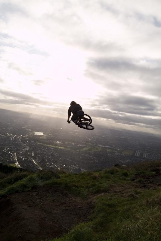 Big hip jump landing to slope infront of rider.