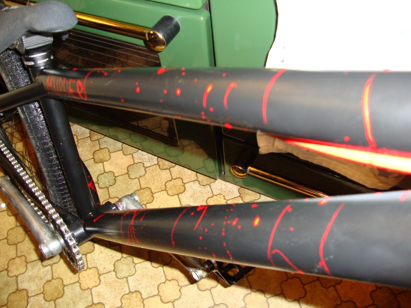 cant really see too much but my fresh painted bike.. satin black with blood splats on it