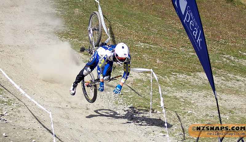 Last rider, last run of practise day for a round of the NZ South Island DH Champs. Mads just caught a wheel and had a huge accident literally across the finish line. He suffered serious arm and wrist injuries. This crash was at top speed down a steep slope.