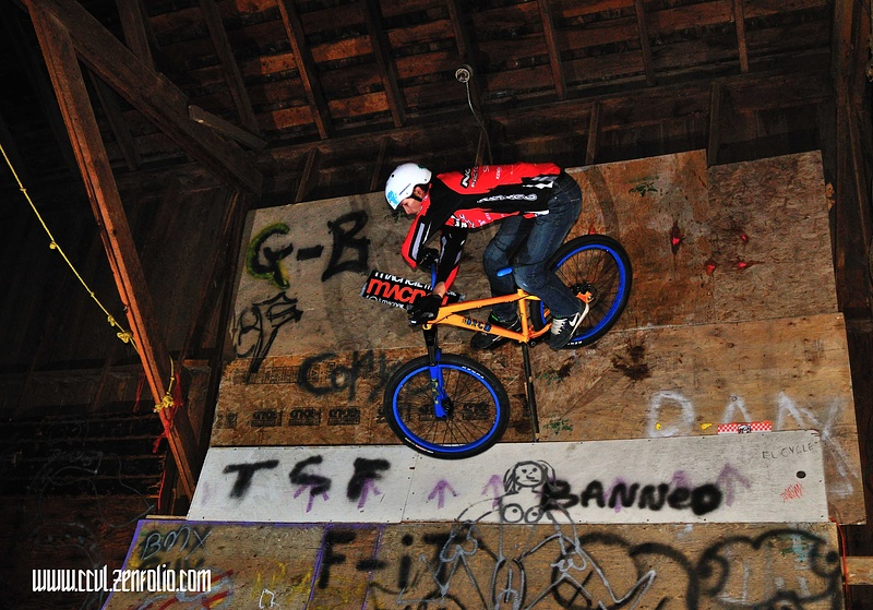 Sam plants the bar spin while against a completely vertical wall and 10 feet in the air.......  www.ccvl.zenfolio.com