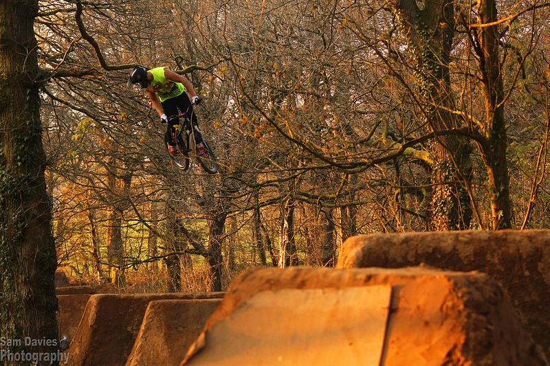 Danny Pace throwing a big 360 over the pristine Moos trails.