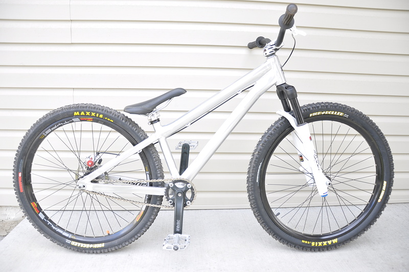 my bike, no bashguard,cut seatpost, and black cable, soon to have small block eight on the rear, dont know for the front tire though