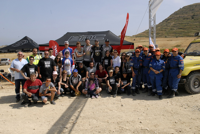 Race crew, riders spectators and the mountain rescue team