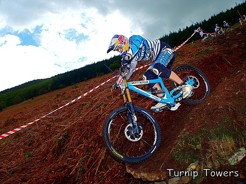 The Welsh Championships race on the new track at Llangollen was eventful for the number of riders struggling to stay on their bikes. The steep, muddy course was causing all kinds of problems. Then along came Rachel Atherton going 'weeeeeeeee' all the way down the course and making it look easy. I just love the group of lads in the background watching while Rachel shows them how to do it!