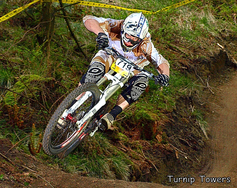Pearce Cycles held two races at Bringewood this year. For the second race they used a new section of track which I hadn't photographed before, but I managed to find one spot where a small jump led to a big sweeping corner and looked really good on camera. I got quite a few pics of riders whipping the jump, but I like this one of Col Williams just for the look of total concentration, I think facial expression can make a big difference to a good photo.