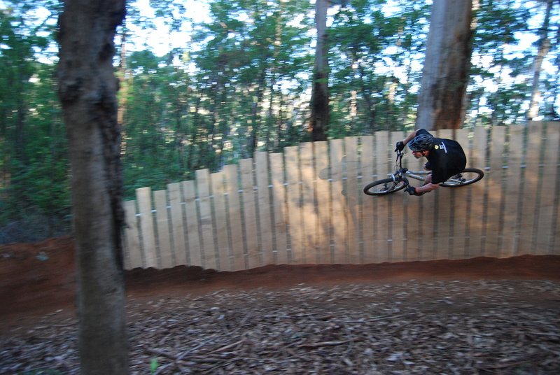 On the jump bike after the race. These berms have a fully welded steel frame supporting the timber.