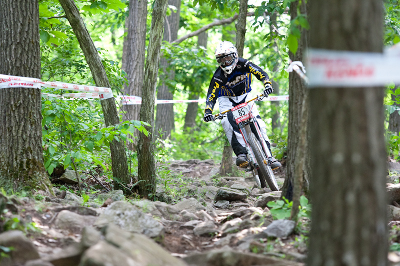 Action during day 1 of pro downhill practice at the US Open of MTB in Vernon, New Jersey.